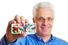 Man holding pill box. Senior citizen holding a german pill box Stock Photo