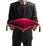 Man holding a pillow Royalty Free Stock Photo