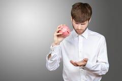 Man holding pink piggy bank Stock Photo
