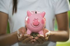 Man holding pink piggy bank, Save money and financial investment, financial or saving concept stock photo