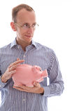 Man holding pink piggy bank saving money isolated on white backg. Round Royalty Free Stock Photography