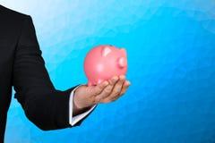 Man holding pink piggy bank Stock Image