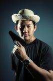 Man holding pistol Stock Images