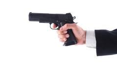 Man holding a pistol Royalty Free Stock Photos
