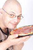 Man holding a pizza Royalty Free Stock Image