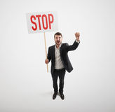 Man holding placard with stop sign Royalty Free Stock Photography