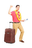 Man holding a plane ticket and gesturing happiness Royalty Free Stock Images
