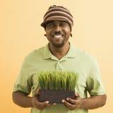 Man holding plant. Royalty Free Stock Photos