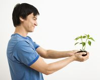 Man holding plant. Royalty Free Stock Photos