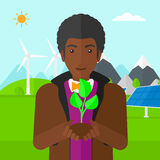 Man holding plant. Stock Image