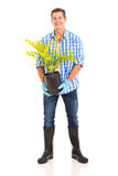 Man holding plant Stock Photos