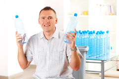 Man Holding Plastic Bottles Stock Images