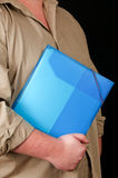 Man is holding a plastic folder for documents Stock Photography