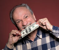 Man holding with pleasure one hundred dollar bill Stock Photos