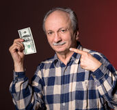 Man holding with pleasure one hundred dollar bill Stock Photography