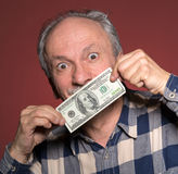 Man holding with pleasure one hundred dollar bill Royalty Free Stock Image