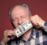 Man holding with pleasure one hundred dollar bill Stock Images