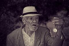 Man Holding Pocket Watch in Grayscale Stock Photos