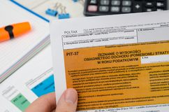 Man holding polish tax form PIT-37 Royalty Free Stock Images