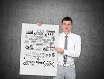 Man holding poster with business scheme Stock Photography