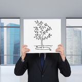 Man holding poster with tree Royalty Free Stock Images