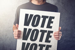 Man holding poster with Vote label Royalty Free Stock Photography