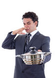 Man holding a pot for cooking that really stinks Royalty Free Stock Photography