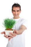 Man Holding Potted Plant Stock Photo
