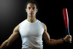 Man holding a power club on black background. Image of a fit male holding a power club Royalty Free Stock Photo