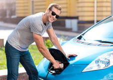 Man holding a power connector for car Stock Photography