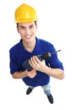 Man holding power drill. Young man over white background Stock Photo