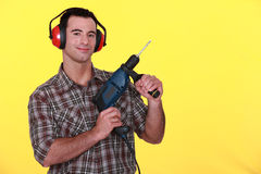 Man holding power drill. Man holding a power drill Royalty Free Stock Photography