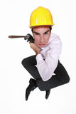 Man holding power drill. Angry man holding power drill Royalty Free Stock Images