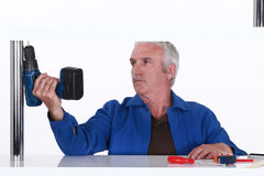 Man holding a power tool Stock Photos