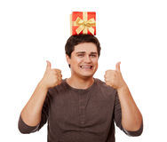A man holding present box on white background. Royalty Free Stock Images