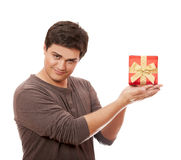 A man holding present box on white background. Stock Images