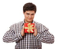 A man holding present box on white background. Royalty Free Stock Photo