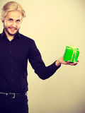 Man holding present green gift box in hand Stock Photos