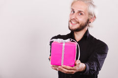 Man holding present pink gift box in hand Stock Photography