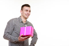 Man holding present pink gift box Stock Images