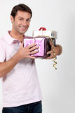 Man holding presents Royalty Free Stock Images