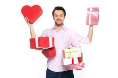 Man holding presents wrapped in gift paper, isolated on white. Royalty Free Stock Photos