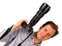 Man holding professional camera. Isolated on white background Royalty Free Stock Photos