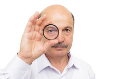 Man is holding a protective filter for the lens and look through Royalty Free Stock Photo