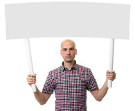 Man holding protest sign. Demonstration concept. Stock Images
