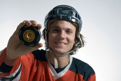 Man Holding Puck - horizontal Stock Images