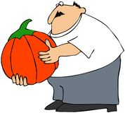 Man holding a pumpkin Royalty Free Stock Photo