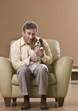 Man Holding Puppy Stock Photography