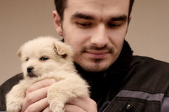 Man holding puppy Royalty Free Stock Photo
