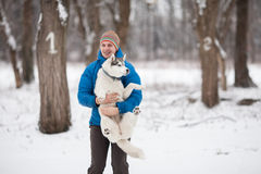Man holding a puppy Stock Photo